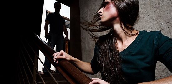 Concept of domestic abuse. Battered woman escaping from man s
