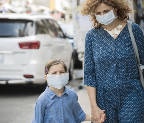 Coronavirus pandemic- single mum and child in masks
