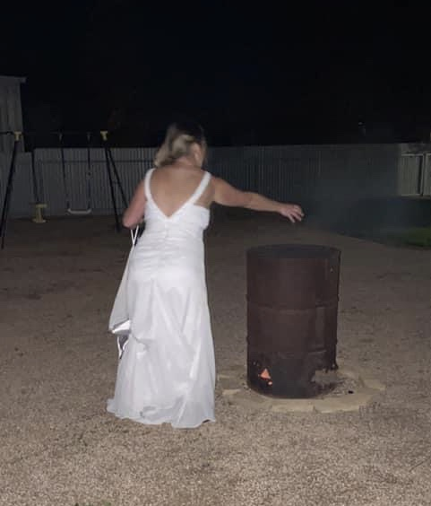 Em McCarthy burnt her wedding gown in a barrel - Photo supplied by Em McCarthy