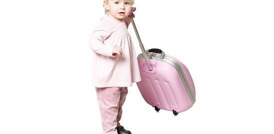 Little child with suitcase